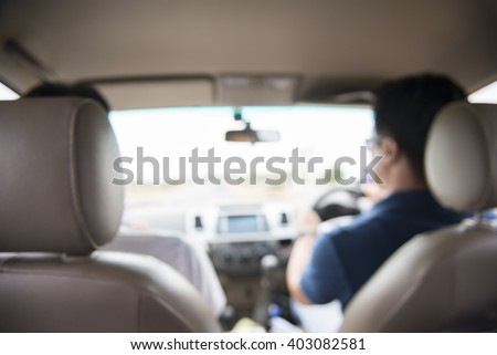 blurred image of people driving car on day time.