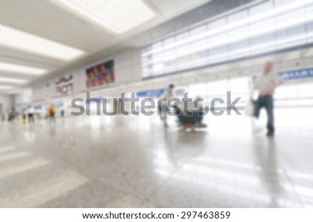 Blurred image of people in the airport - stock photo