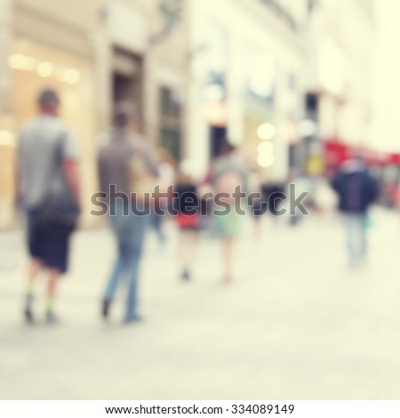 Blurred image of people in the city. - stock photo