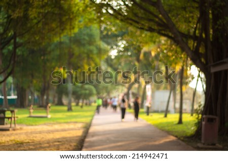 Blurred image of people jogging at the park - stock photo