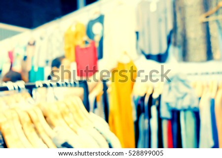 blurred image of people shopping in store.