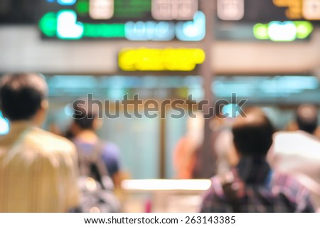 Blurred image of people waiting arrival passengers at the airport terminal - can be used as background - stock photo