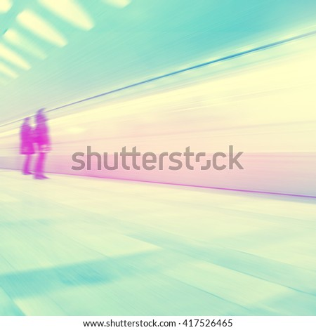 Blurred image of people waiting at subway station. Vintage style. - stock photo