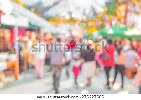 Blurred image of people walking at day market  in sunny day, blur background with bokeh - stock photo