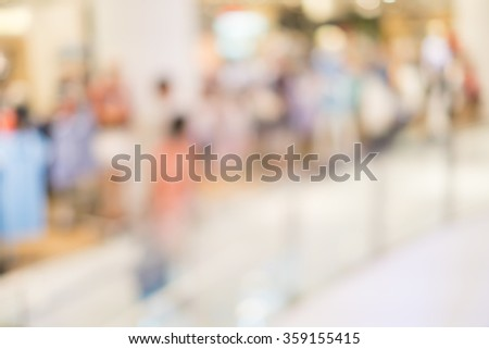 blurred image of shopping mall and people for background usage . - stock photo