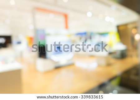 blurred image of shopping mall and people with vintage tone for background usage . - stock photo
