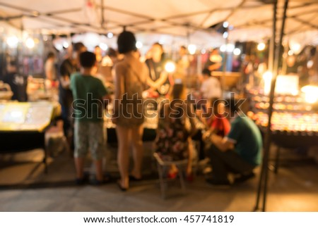 Blurred image of street market at night use for abstract background
