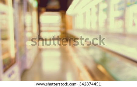 blurred image of supermarket and variety product for background usage . (vintage tone) - stock photo