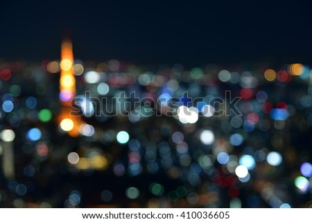 Blurred image of Tokyo Tower and Tokyo nightscape - stock photo