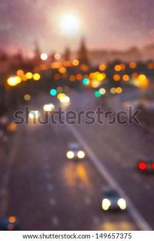 Blurred image of traffic in Moscow at dusk. - stock photo