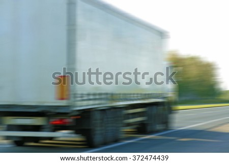 blurred image or photo. Truck on the road - stock photo