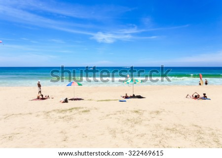 Blurred image : Tourist at Karon beach in phuket island, Andaman sea, Thailand