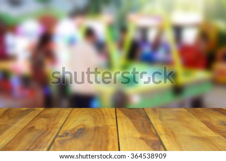 blurred image wood table and abstract Children's playground at public park - stock photo