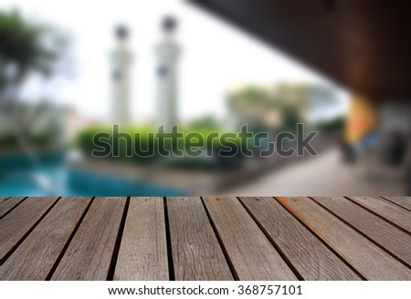 blurred image wood table and abstract swimming pool and  pool bed - stock photo
