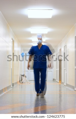 blurred in motion doctor in long corridor