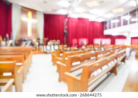 Blurred interior of empty church with empty pews - stock photo