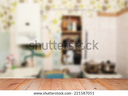 Blurred interior of little kitchen with wooden surface - stock photo
