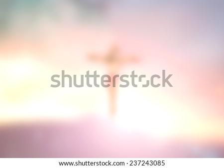 Blurred Jesus on the cross over sunset. Christmas background, Forgiveness, Mercy, Humble, Repentance, Reconcile, Adoration, Glorify, Redeemer, Redemption, Gospel, Love, Faith, Hope concept. - stock photo