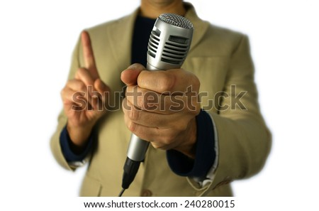 blurred journalist  holding a microphone over white background                             - stock photo