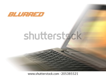 Blurred laptop on a white background. Added blur effect - stock photo