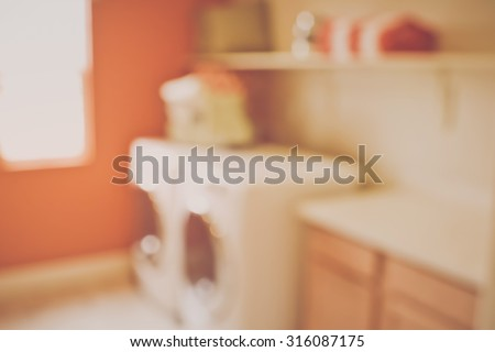 Blurred Laundry Room with Washer and Dryer with Retro Instagram Style Filter - stock photo
