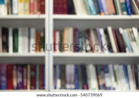 Blurred library bookshelf with lots of colorful books. School library books blurred