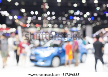 Blurred light in room with people and  spectator have a look on luxury car. Bangkok international Motor show exhibition.Thailand.
