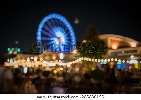 Blurred light of ferris wheel in Bangkok , Thailand - Blurred defocused night lights - stock photo