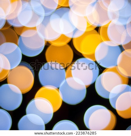 Blurred lights background. Christmas defocused lights background. Bokeh sparkling lights. Abstract colorful background. - stock photo