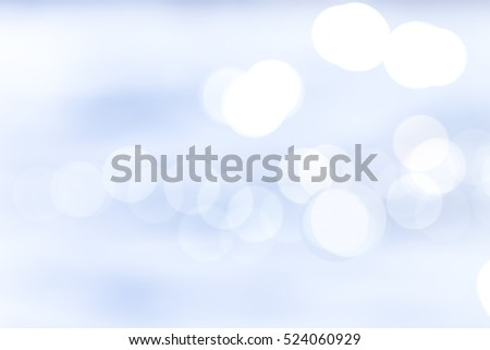 BLURRED LIGHTS BACKGROUND, SPACE FOR TEXT ON BLUE AND WHITE CIRCLES
