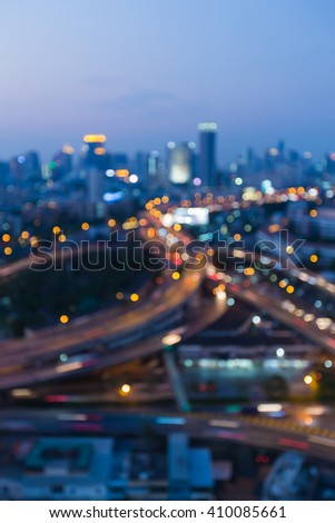 Blurred lights bokeh, downtown highway intersection night view - stock photo