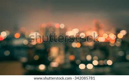 blurred lights cityscape at night with vintage tone : city blur - stock photo