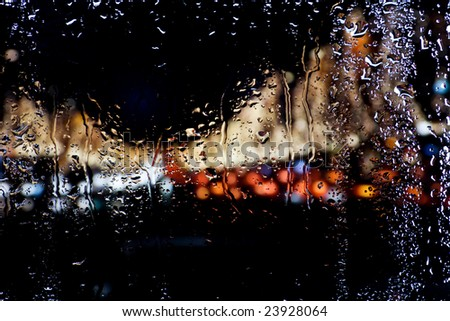 Blurred lights for wet window - stock photo