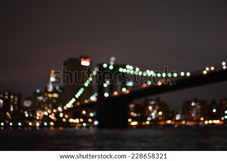 Blurred lights of Brooklyn Bridge and New York City. Night view - stock photo