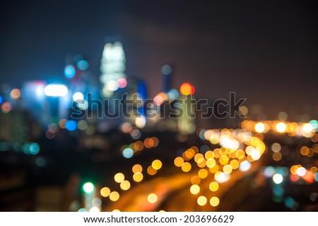 Blurred lights of Kuala Lumpur skyline, round shape bokeh - stock photo