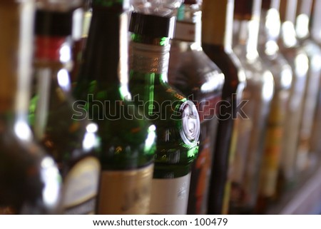 Blurred liquor bottles on a bar. - stock photo