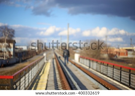 Blurred male walking on the railway bridge