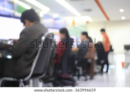 blurred man employee working with display computer monitoring in office room concept:blur group of people research/develop/analysis new technology of world wide connection concept:blurry activity work - stock photo