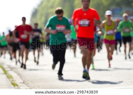 Blurred mass of marathon runners - stock photo