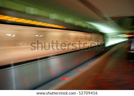 Blurred metro unit in motion - stock photo