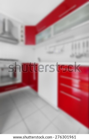 Blurred modern red and white kitchen. - stock photo