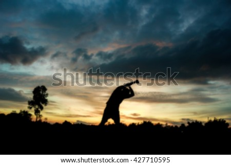 Blurred motion Fitness on silhouette sunrise A man workout wellness concept. - stock photo