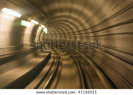 Blurred motion in metro tunnel. Copenhagen metro - stock photo