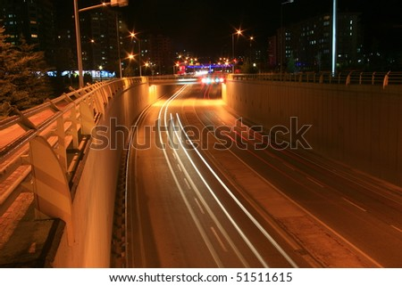 Blurred Motion of Car Lights on Highway at Night