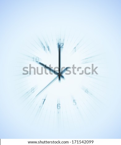 Blurred motion of clock face - stock photo