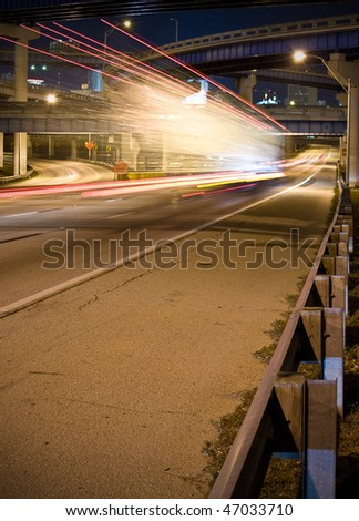 Blurred motion of lights on a highway, night photo with long exposure - stock photo