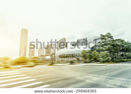Blurred motion of modern skyline and urban street  - stock photo
