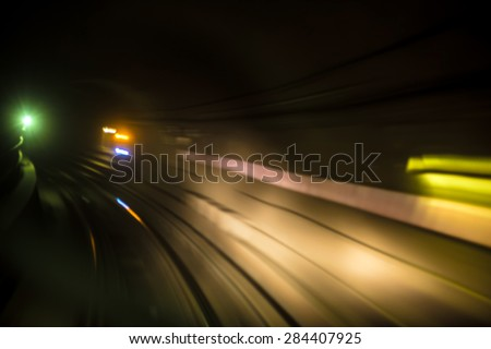 Blurred motion of New York City subway tube / tunnel going around bend - stock photo