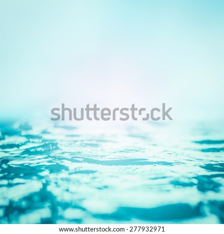 Blurred natural background of rippled water surface in cyan turquoise blue color tone: Blurry aqua spa background - stock photo
