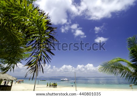 blurred nature background the beauty of tropical beach with blue sky and cloudy cloud. bamboo hut on the beach.
